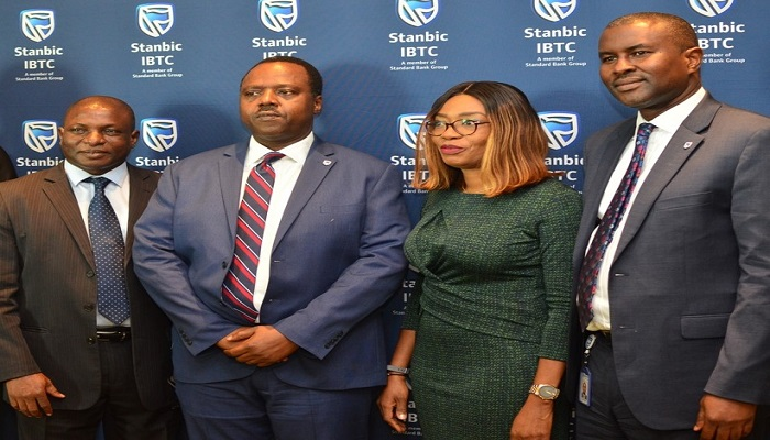 Eric Fajemisin, CEO of Stanbic IBTC Pension Managers and other officers of the company