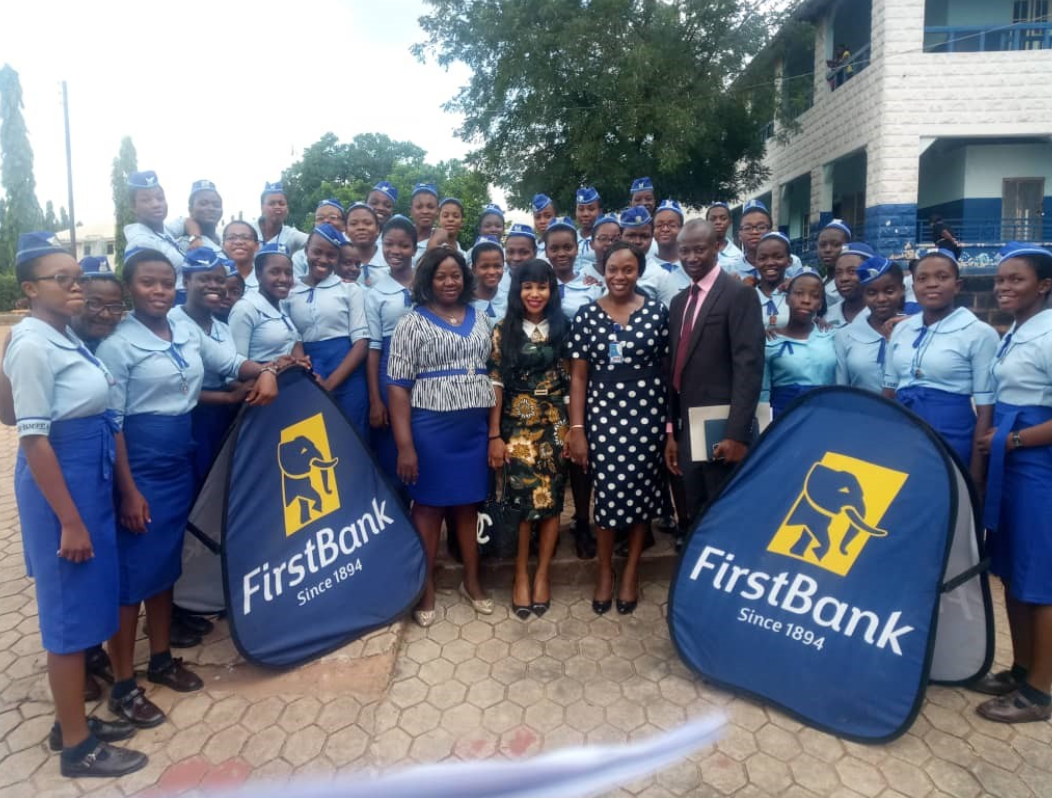 Cross Section of Students of Holy Rosary College, Uwani Enugu State with officials of FirstBank during the commemoration of World Savings Day.